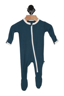 front shows zip front with white hemlines all over. onesie is solid navy blue.