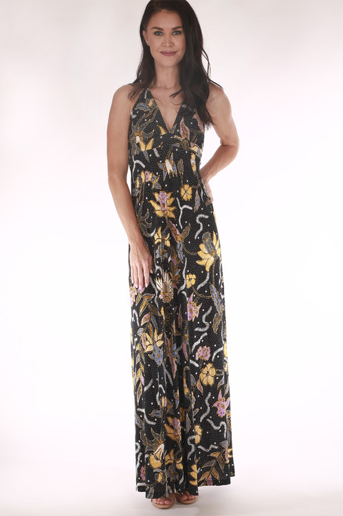 front shows full length maxi with V-neckline, all over black background print with yellow, purple, and blue flowers.