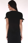 front shows black maxi featuring tied short sleeves.