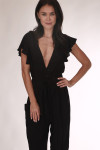 front close up shows deep V neckline with ruffle sleeves, elastic waistband and tie