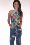 front shows all over flower print with light blue background. High neck and waist tie.