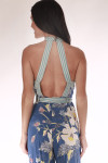 back shows open back with thin straps.