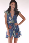 front features all over floral print with blue background, deep V neckline with super short hemline.