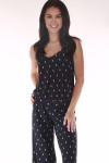 front shows navy and white polka dot print all over with spaghetti straps, waistband and wide legs.