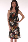 front shows strapless dress with black background and orange, red and green flowers all over with ruffle overlay at top and length that hits right at knees.