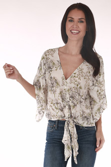 front shows print with white background and pink/grey flowers all over with deep v-neck line and tie at front