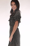 side shows black and white polka dot material with ruffle detailing at sleeve