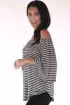 side shows off the shoulder top with vertical black and white stripe print and 3/4 length flare sleeves