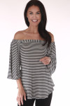 front shows off the shoulder top with vertical black and white stripe print and 3/4 length flare sleeves