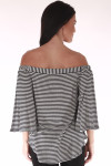 back shows off the shoulder top with vertical black and white stripe print and 3/4 length flare sleeves