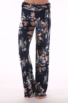 front shows all over floral print with navy background and light blue and tan flowers. pants have side tie on left side