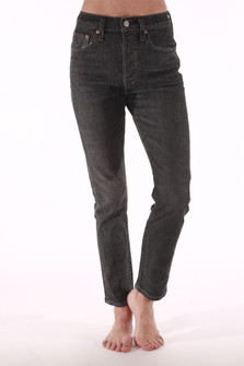 front shows fading black ankle length jeans featuring a button fly front with tapered skinny leg and quality Italian Selvedge denim material & stitching. Two front pockets.