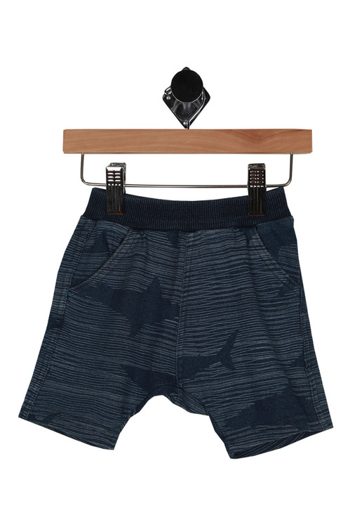 front shows dark blue shorts with an elastic waistband with front & back pockets and all over striped with faded shark print all over.
