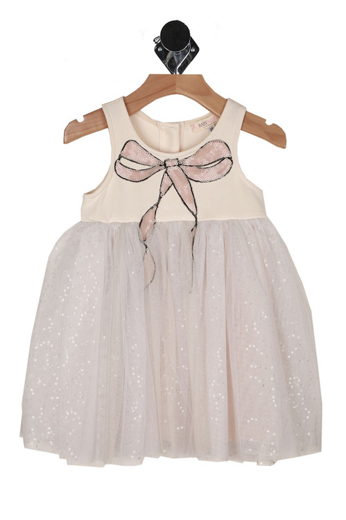 front shows ivory dress with pink sequined bow at neck line with tulle & sequin bottom and fully lined underneath. Three button closure at back.