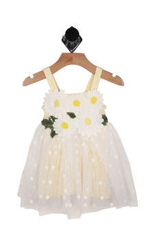 front shows embroidered daisies at top with polka dot white & yellow print all over and white tulle skirt