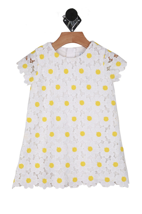 Front shows white and yellow daisy patterned crochet dress.