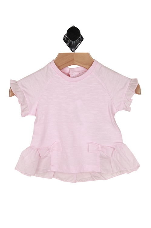 front shows ruffled hemlines with all over light pink color.