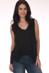 Front shows black tank top with hi-lo hemline, tiered ruffle hemline, light semi-sheer material, and v-neckline. Shown worn with Blue jeans.