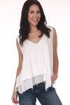 Front shows white tank top with hi-lo hemline, tiered ruffle hemline, light semi-sheer material, and v-neckline. Shown worn with Blue jeans.