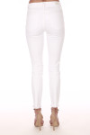 back view shows white ankle length jeans with heavy fraying at bottom hemline with mid rise and 2 back pockets.