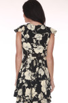 Front: Black and ivory flower print mini dress with short ruffled shoulders.