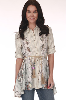 Front shows ivory multi floral design blouse with elbow length sleeves and waste tie with pink flower.