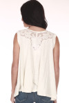 back shows tank in all cream color with top chest mesh embroidering and tank sleeves.