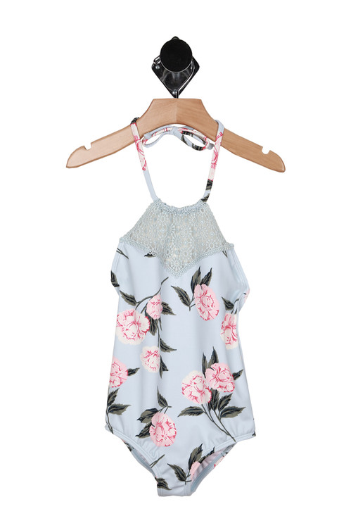 front shows halter top tie with crochet top front and all over floral print in baby blue, pink and green.