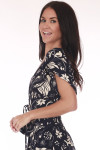 Sideshows black and ivory multi flower patterned crop top with mid arm length shoulders.