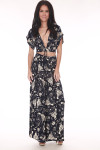 Full front shows black and ivory multi flower patterned lace up tie crop top with low v shape and mid arm length shoulders. Shown worn with matching long skirt.