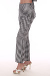 Side shows black and white checkered wide ankle length Parker pants shown with white heels.