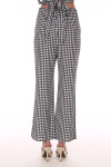 Back shows black and white checkered wide ankle length Parker pants.