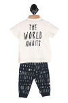 """Back shows two piece white tee top with words """"The World Awaits"""" written on shirt and multi patterned long pants."""