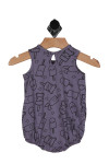 this bubble onesie has purple background with pictures of ice cream cones and Popsicles all over in black.