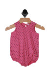 this bubble onesie has hot pink background with pictures hearts all over in black.