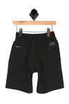 Back: Black stretch board shorts with pockets and black  tag above right pocket.