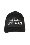 "front shows ""yes she can"" embroidered in white writing on all black hat."