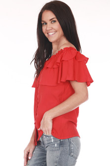 Side shows red ruffled off shoulder blouse with button up front.
