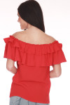 Back shows red two layered ruffled off shoulder blouse.