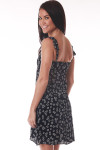 Back shows black and white mini floral dress with ruffled off shoulder sleeves.