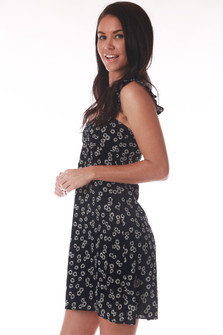 Side shows black and white mini floral dress.