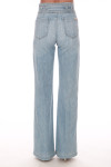 back shows belted top with no back pockets and super wide flare bottoms in a light blue denim color