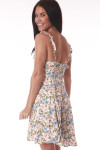 back shows floral print with white back ground and pink, baby blue and green flowers all over with ruffle spaghetti straps, mini length at mid calf and smocked back