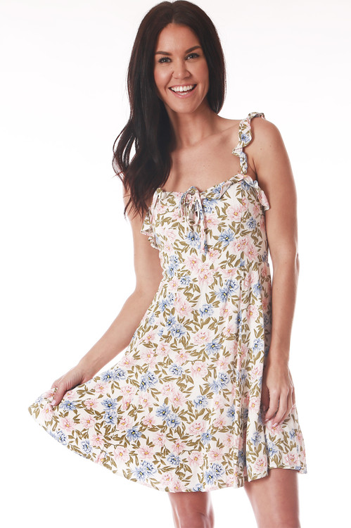 front shows floral print with white back ground and pink, baby blue and green flowers all over with ruffle spaghetti straps, mini length at mid calf and slight sweet heart neckline.