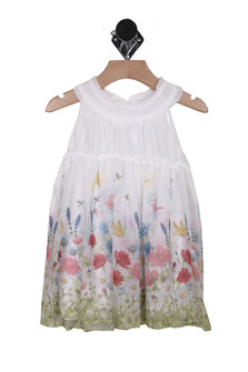 Front shows short sleeve white spring dress with multiple  colorful flower design at bottom of dress.