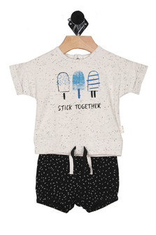 "Front shows two piece set featuring a snap-back top with ""stick together"" with popsciles and specks printed at front and black and white speckled shorts with elastic waistband and bottom leg openings."