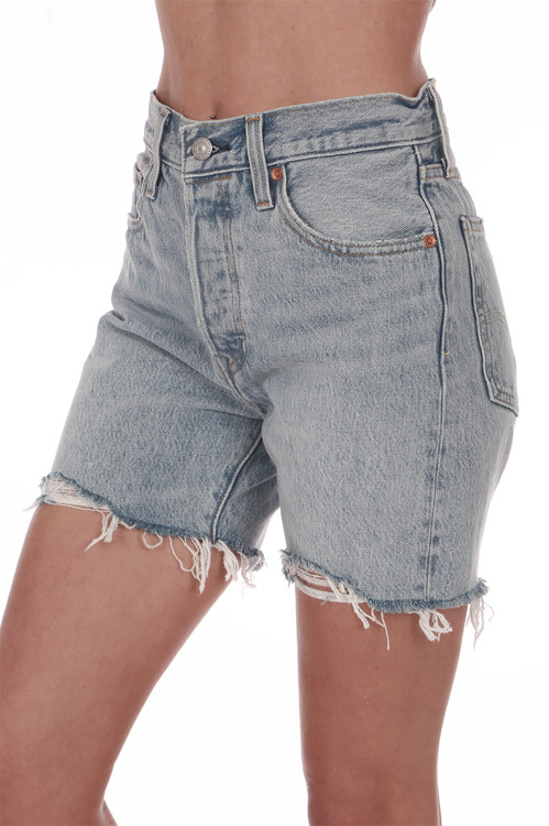 Front: Mid thigh shredded denim shorts with pockets.