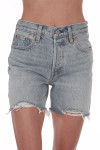 Front shows mid thigh shredded light denim shorts with pockets.