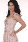 Side shows Mauve and white polka a dot patterned lace up tie maxi dress with short ruffled off shoulder sleeves.