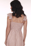 Back shows Mauve and white polka a dot patterned maxi dress with smock back short ruffled off shoulder sleeves.